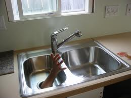 a local plumber provides drain cleaning service during a disposal repair