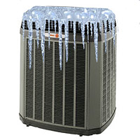 a black ac unit suffers a freeze up and has ice on the top